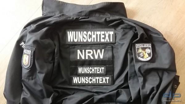Rückenschild aus 100% Nomex Comfort in parisblau 38x16cm mit Wunschtext in reflex silber